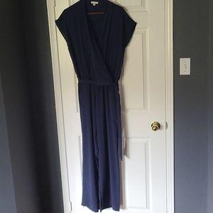 Halston silky, navy short sleeved jumpsuit